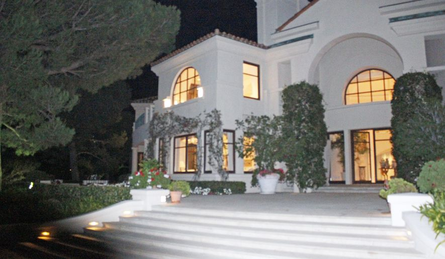 This Oct. 17, 2011 photo provided by U.S. Immigration and Customs Enforcement (ICE) shows the exterior of the Malibu, Calif., mansion of the son of Equitorial Guinea's president, Teodoro Nguema Obiang Mangue, during the execution of a search warrant. Mangue must sell the $30 million Malibu mansion, a Ferrari and Michael Jackson memorabilia and then give the proceeds to the citizens of his impoverished country, under a settlement announced Friday, Oct. 10, 2014 by U.S. authorities who said he bought the lavish items with money stolen from the African nation. Mangue, who is also Equatorial Guinea's second vice president, agreed to turn over $20 million from the sale of these assets to a charitable organization to be used to benefit the people of his country, the U.S. Department of Justice said. Another $10.3 million will be forfeited to the U.S. government. (AP Photo/U.S. Immigration and Customs Enforcement)