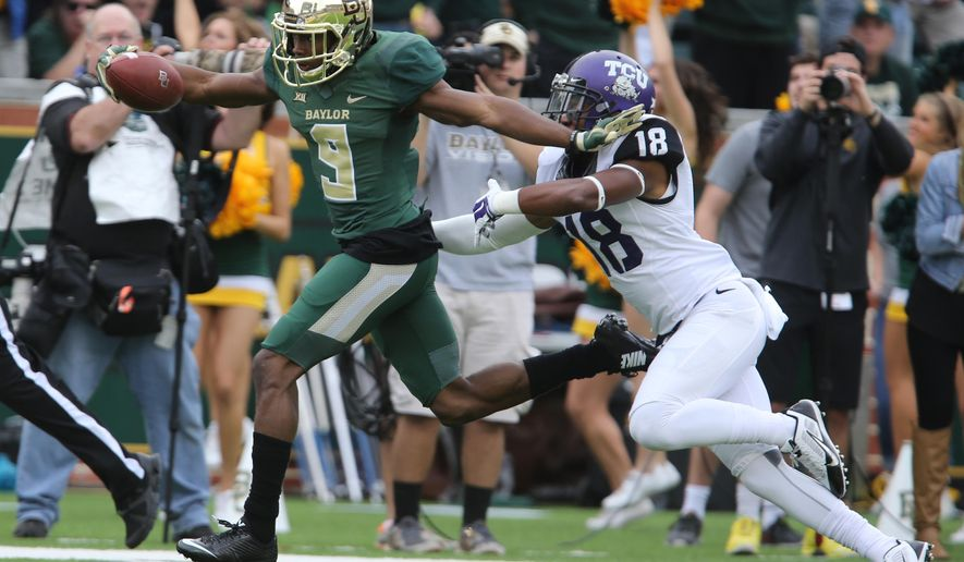 Baylor wide receiver KD Cannon (9) scores past TCU cornerback Corry Omeally, right, in the first half of an NCAA college football game, Saturday, Oct. 11, 2014, in Waco, Texas. (AP Photo/Waco Tribune Herald, Jerry Larson)
