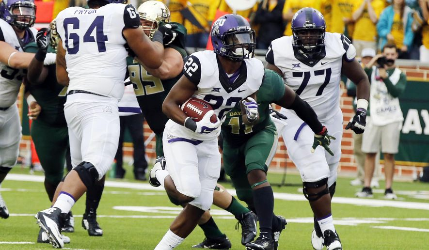 TCU running back Aaron Green (22) scores against Baylor linebacker Taylor Young (11) in the second half of an NCAA college football game, Saturday, Oct. 11, 2014, in Waco, Texas. (AP Photo/Waco Tribune Herald, Rod Aydelotte)