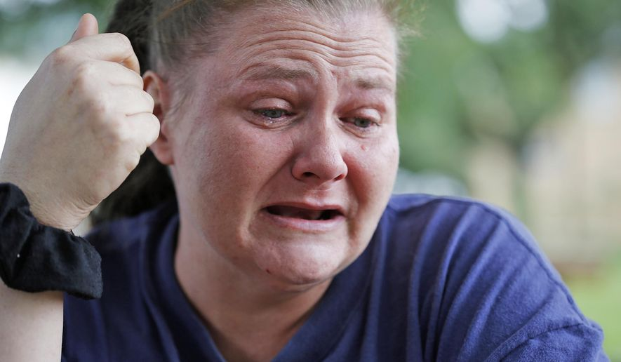 Maria Ridgway cries while talking about her daughter, Skyah Vest, 14, who was adopted as Katlyn Ann Shope Williams, and died of a drug overdose about two months after running away from her adoptive family in Galion, Ohio. (AP Photo/Columbus Dispatch, Jonathan Quilter)