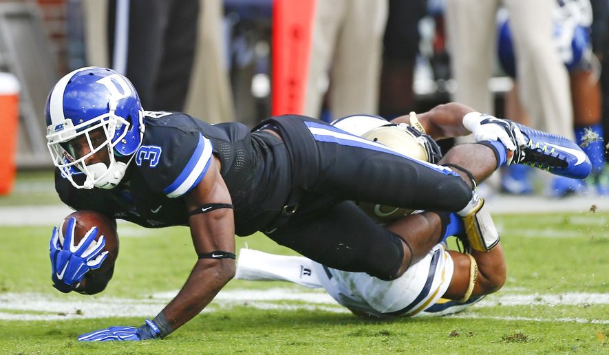 Duke wide receiver Jamison Crowder (3) is brought down by Georgia Tech safety Isaiah Johnson (1) in the second half of an NCAA college football game Saturday, Oct. 11, 2014, in Atlanta.  Duke won 31-25. (AP Photo/John Bazemore)