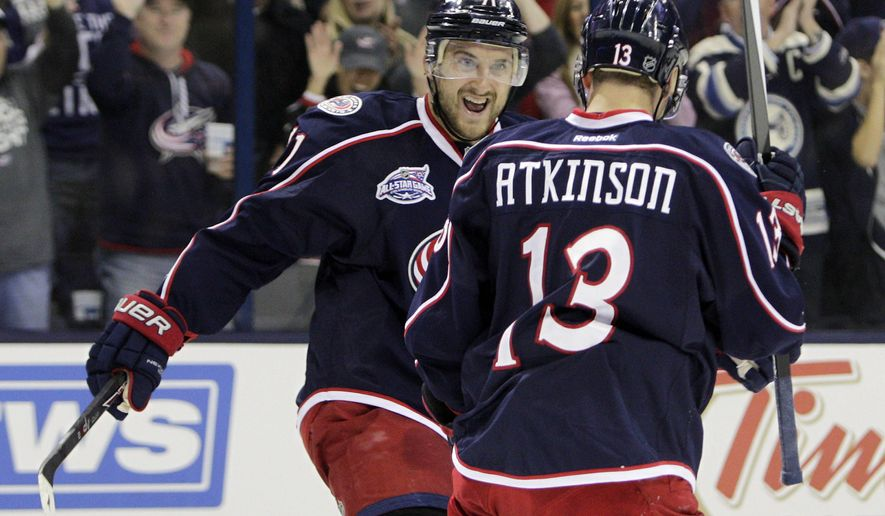 Columbus Blue Jackets' Nick Foligno, left, and Cam Atkinson celebrate Atkinson's goal against the New York Rangers during the second period of an NHL hockey game Saturday, Oct. 11, 2014, in Columbus, Ohio. (AP Photo/Jay LaPrete)