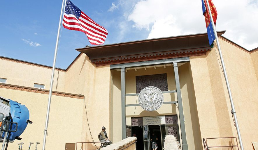 """The old district courthouse building in downtown Santa Fe, NM has been transformed into a U.S. Embassy for the pilot episode of a new TV show call """"Stanistan"""" on Thursday, Oct. 9, 2014.  (AP Photo/The Santa Fe New Mexican, Jane Phillips)"""