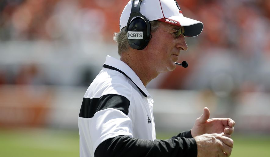 Cincinnati head coach Tommy Tuberville gestures in the first half of an NCAA college football game against Miami, Saturday, Oct. 11, 2014, in Miami Gardens, Fla. (AP Photo/Lynne Sladky)