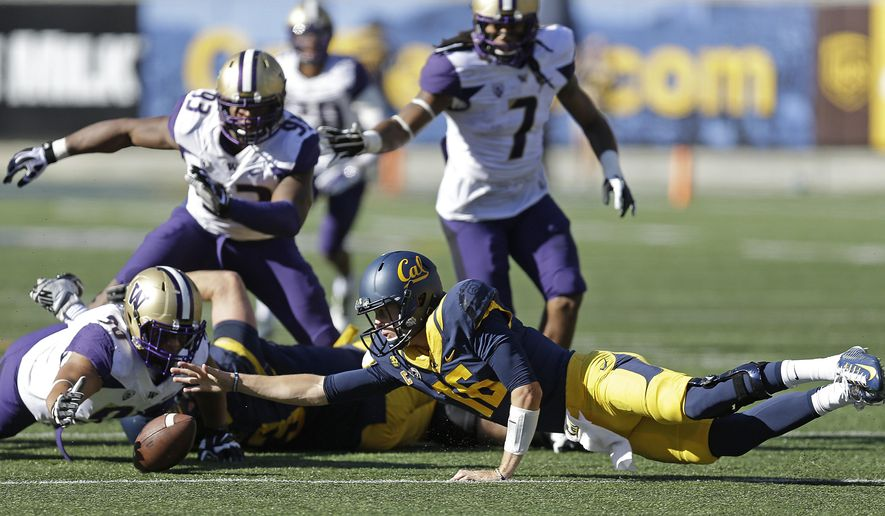 California's Jared Goff (16) reaches for a fumble which was recovered by Washington's Taniela Tupou (90) during the first half of an NCAA college football game Saturday, Oct. 11, 2014, in Berkeley, Calif. (AP Photo/Ben Margot)
