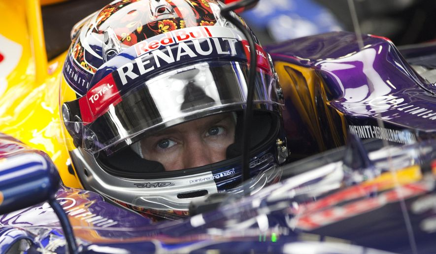 Red Bull driver Sebastian Vettel of Germany prepares to start from the garage during the third free practice at the 'Sochi Autodrom' Formula One circuit , in Sochi, Russia, Saturday, Oct. 11, 2014. Formula One championship leader Lewis Hamilton edged Mercedes teammate Nico Rosberg in the final practice Saturday for the Russian Grand Prix. The inaugural Russian GP will be held on Sunday in Sochi, the Black Sea resort that hosted this year's Winter Olympics.(AP Photo/Pavel Golovkin)