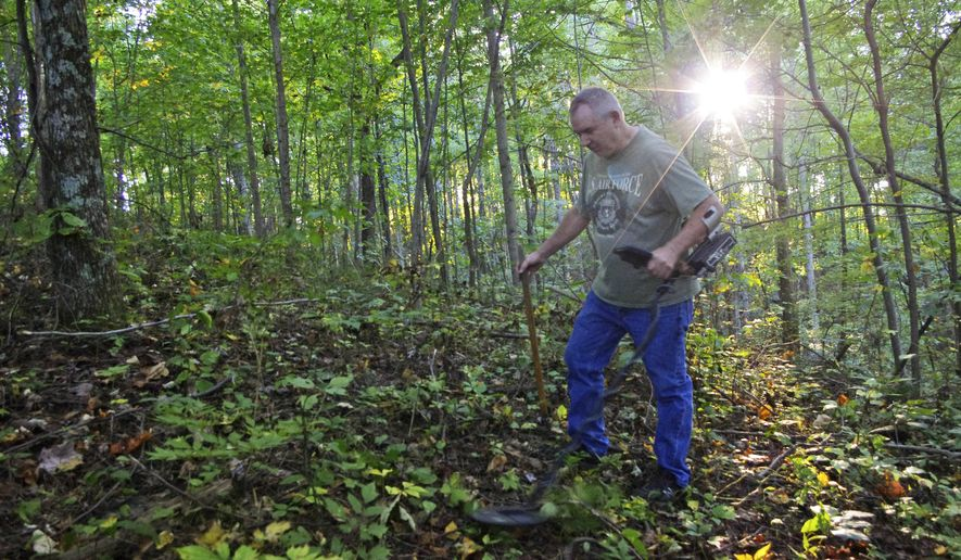 In this Thursday Sept. 25, 2014 photo, Kenny King, 59, of Ethel, W.Va., scours the grounds of Blair Mountain, with a metal detector in Blair Mountain, W.Va.  The Battle of Blair Mountain, a five-day skirmish between law enforcement and union miners in the coalfields of southern West Virginia, occurred here. Environmental groups, including the Sierra Club, have joined King in petitioning the National Register of Historic Places to declare Blair Mountain a historic landmark. (AP Photo/Matt Stroud)