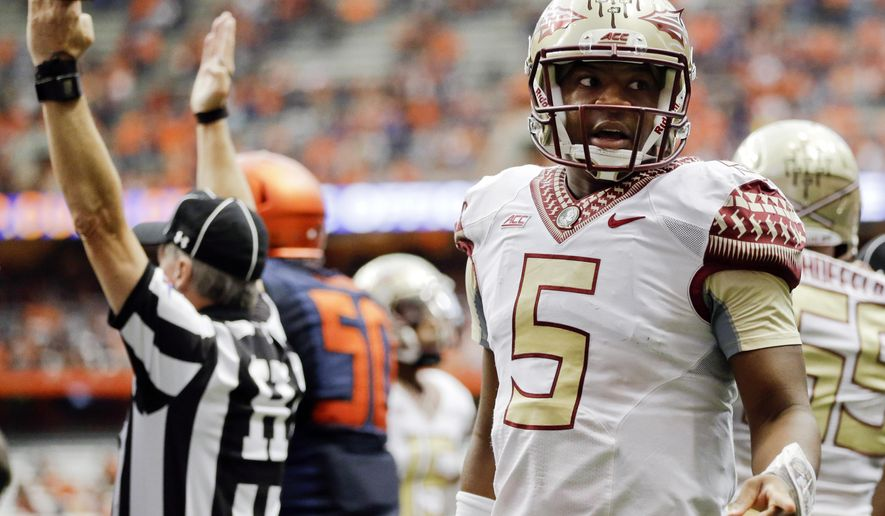 Florida State quarterback Jameis Winston (5) talks to Syracuse's Darius Kelly, not shown, after teammate Dalvin Cook scored a touchdown during the second half of an NCAA college football game Saturday, Oct. 11, 2014, in Syracuse, N.Y. (AP Photo/Frank Franklin II)