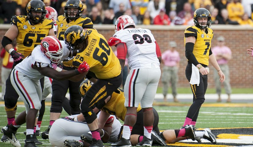 Missouri quarterback Maty Mauk, right, watches the action as his fumble is recovered by Georgia during the second quarter of an NCAA college football game Saturday, Oct. 11, 2014, in Columbia, Mo. (AP Photo/L.G. Patterson)