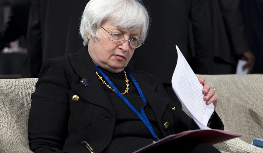 U.S.Federal Reserve Chair Janet Yellen read her notes at the International Monetary and Financial Committee meeting during the World Bank Group-International Monetary Fund Annual Meetings at IMF headquarters in Washington, Saturday, Oct. 11, 2014.  (AP Photo/Jose Luis Magana)