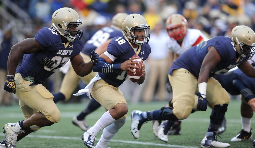 Navy's quarterback Tago Smith keeps the ball and runs for a first down during the second quarter of an NCAA college football game against VMI, Saturday, Oct. 11, 2014, in Annapolis, Md. (AP Photo/Capital Gazette, Paul W. Gillespie)