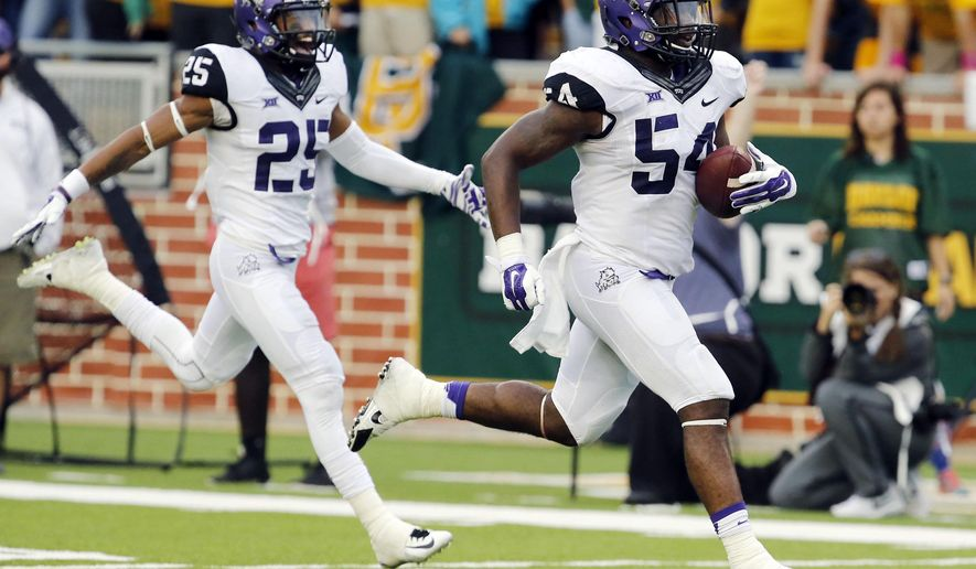 TCU linebacker Marcus Mallet (54) runs back an interception against Baylor while teammate TCU safety Michael Downing (25) follows in the second half of an NCAA college football game against Baylor, Saturday, Oct. 11, 2014, in Waco, Texas. (AP Photo/Waco Tribune Herald, Rod Aydelotte)