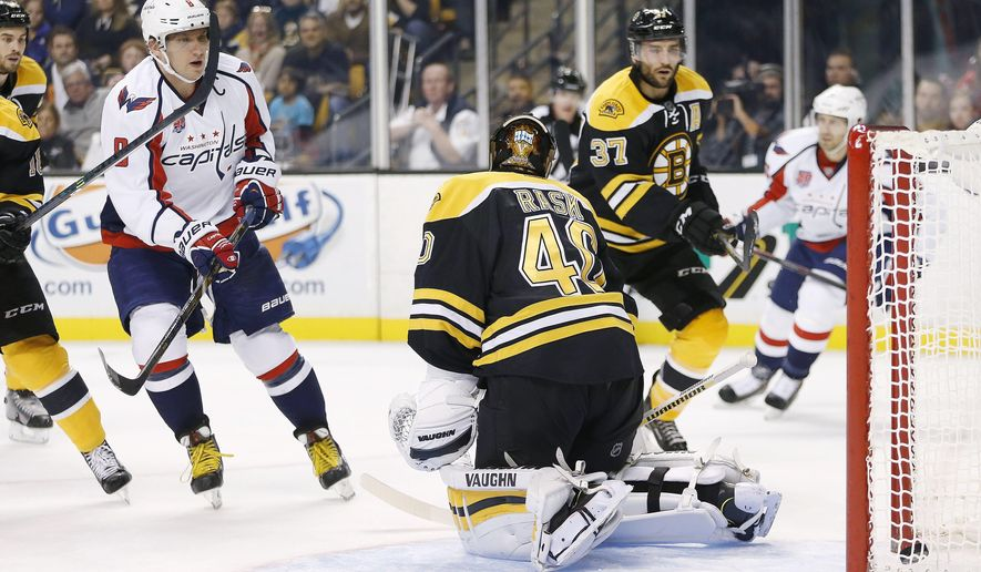 Washington Capitals left wing Alex Ovechkin (8), of Russia, scores his second goal of the first period against Boston Bruins goalie Tuukka Rask (40), of Finland, during an NHL hockey game in Boston, Saturday, Oct. 11, 2014. (AP Photo/Michael Dwyer)