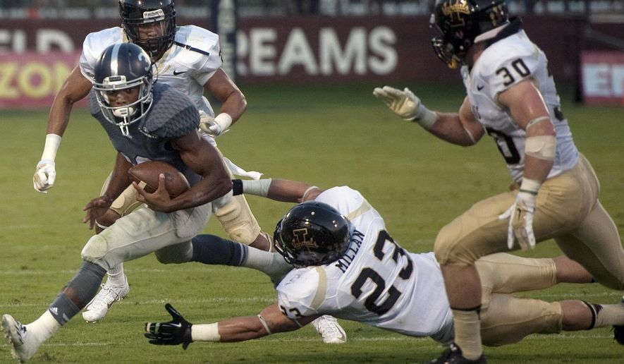 Georgia Southern University running back, Matthew Breida, evades a tackle from University of Idaho's Marc Millan to score a touchdown during the first half of an NCAA college football game, Saturday, Oct. 11, 2014 in Statesboro, Ga. (AP Photo/Savannah Morning News, Brittney Lohmiller) THE EXAMINER.COM OUT; SFEXAMINER.COM OUT; WASHINGTONEXAMINER.COM OUT