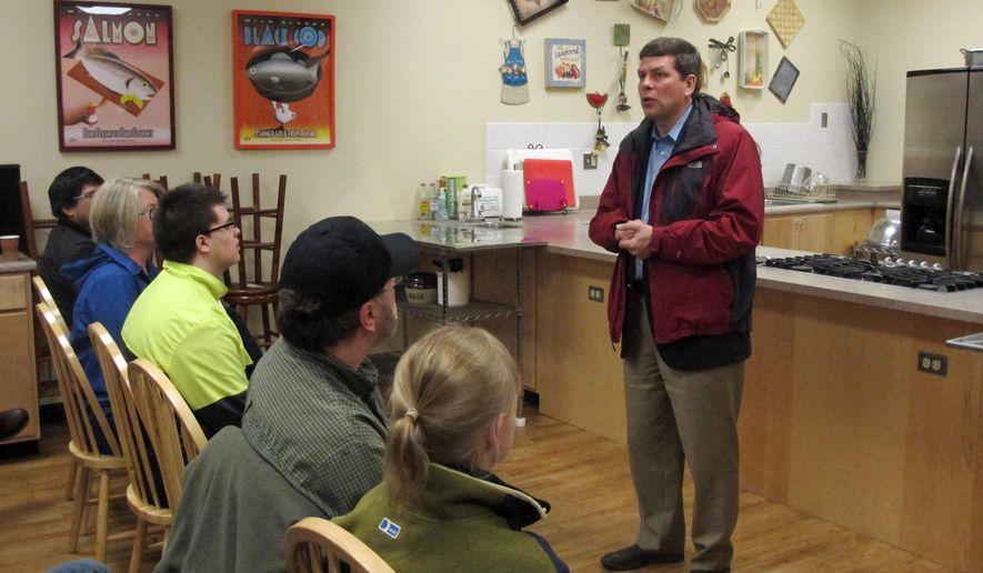 U.S. Sen. Mark Begich, D-Alaska, speaks to volunteers on Saturday, Oct. 11, 2014, in Juneau, Alaska. Begich made the stop with Sen. Heidi Heitkamp, D-N.D., who is not pictured. (AP Photo/Becky Bohrer)