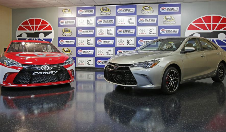 A 2015 Toyota Camry race car, left, is shown with a street version of the 2015 Camry during a news conference before the NASCAR Sprint Cup series Bank of America 500 auto race at Charlotte Motor Speedway in Concord, N.C., Saturday, Oct. 11, 2014. (AP Photo/Terry Renna)