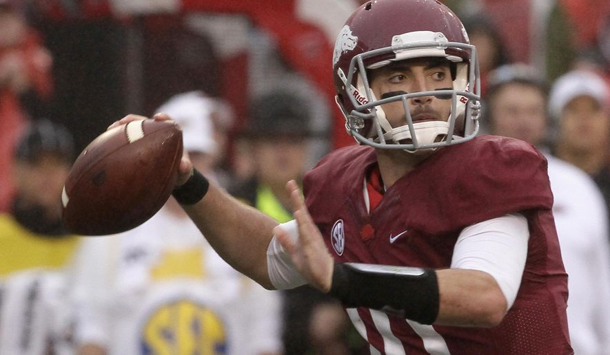 Arkansas quarterback Brandon Allen passes in the first half of an NCAA college football game against Alabama in Fayetteville, Ark., Saturday, Oct. 11, 2014. (AP Photo/Danny Johnston)