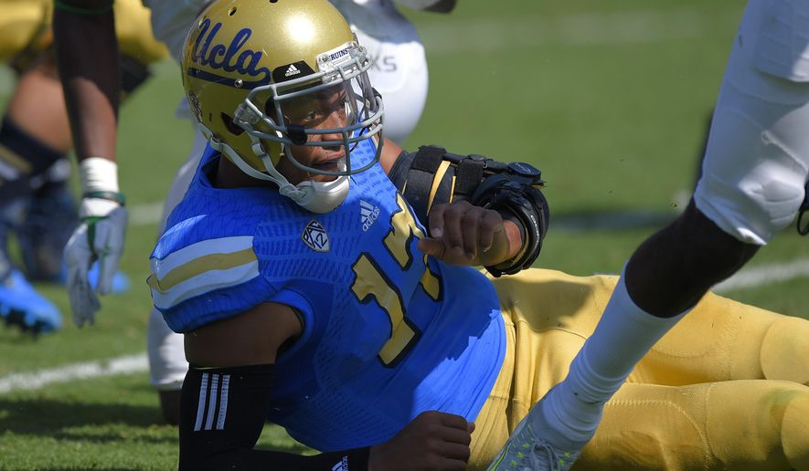 UCLA quarterback Brett Hundley lays on the ground after fumbling the ball for a turnover during the first half of an NCAA college football game against Oregon, Saturday, Oct. 11, 2014, in Pasadena, Calif. (AP Photo/Mark J. Terrill)