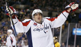 Washington Capitals left wing Alex Ovechkin, of Russia, celebrates his second goal of the first period during an NHL hockey game against the Boston Bruins in Boston, Saturday, Oct. 11, 2014. (AP Photo/Michael Dwyer)