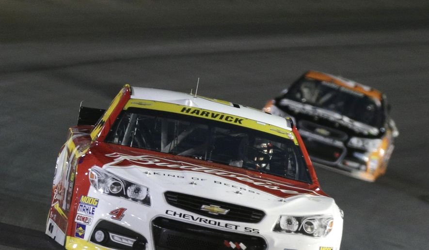 Kevin Harvick (4) races out of Turn 4 during the NASCAR Sprint Cup series Bank of America 500 auto race at Charlotte Motor Speedway in Concord, N.C., Saturday, Oct. 11, 2014. (AP Photo/Chuck Burton)