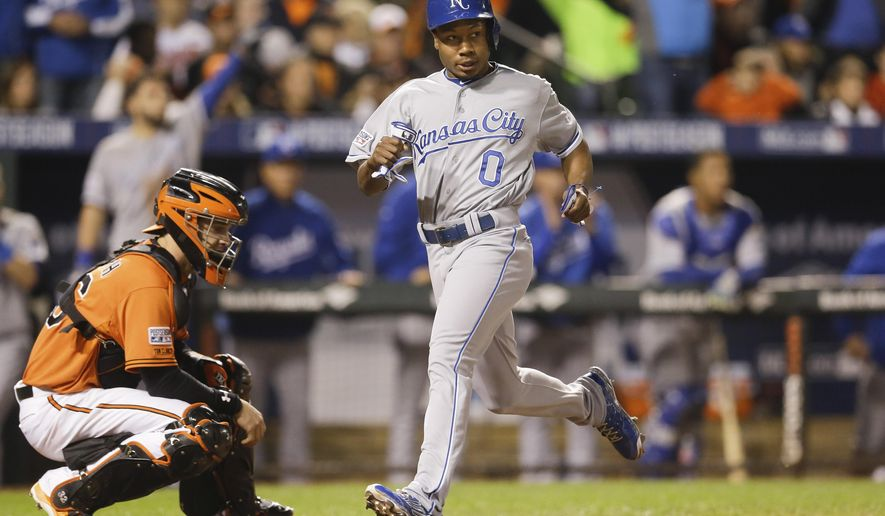 Kansas City Royals' Terrance Gore (0) scores on a double by Alcides Escobar during the ninth inning of Game 2 of the American League baseball championship series against the Baltimore Orioles Saturday, Oct. 11, 2014, in Baltimore. (AP Photo/Patrick Semansky)