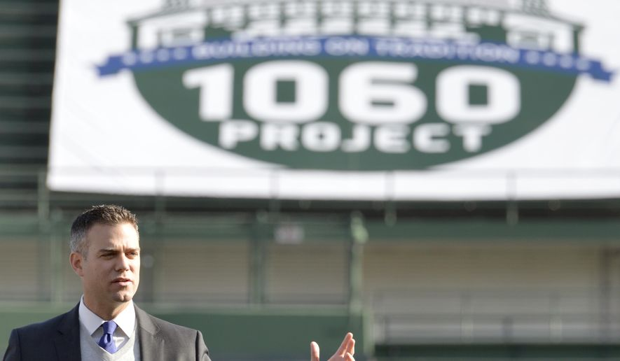 Chicago Cubs president, baseball operations, Theo Epstein speaks at Wrigley Field during the groundbreaking ceremony on Saturday, Oct. 11, 2014 in Chicago. The Chicago Cubs have officially launched their Wrigley Field renovation project.  The first phase of the privately funded $575 million project will add new bleachers and seven outfield signs. Work actually started in September after the season ended, despite a legal feud between the team and owners of rooftop clubs, who fear their views into the stadium will be blocked.   (AP Photo/Sun-Times Media, Michael Schmidt)  MANDATORY CREDIT, MAGS OUT, NO SALES