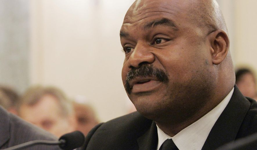 FILE - In this Sept. 18, 2007 file photo, former Chicago Bears safety Dave Duerson, a trustee for the Burt Bell/Pete Rozell NFL Player Retirement Plan, testifies on Capitol Hill in Washington. Tuesday remains the deadline to opt out of the NFL's class-action settlement of concussion claims after a judge denied requests by former players for an extension. Lawyers for Duerson's family and others had asked for a delay until after objections are weighed at a Nov. 19 fairness hearing. Duerson committed suicide on Feb. 17, 2011. (AP Photo/Susan Walsh, File)