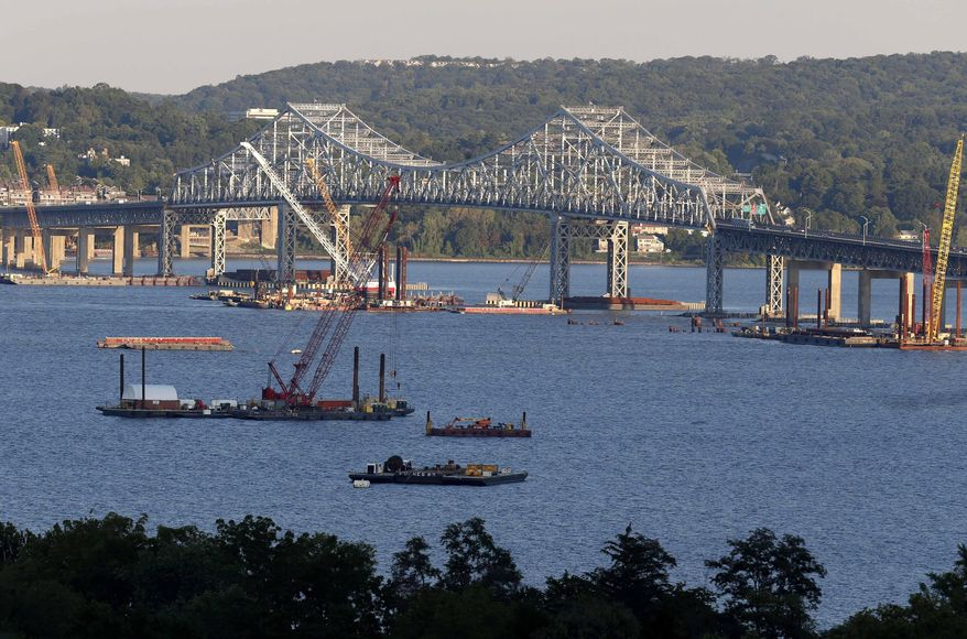 FILE--In this Sept. 18, 2014 file photo, construction equipment is positioned near the Tappan Zee Bridge as seen from Nyack, N.Y. New York Gov. Andrew Cuomo is running for a second term without having to face the political fallout from big decisions on fracking and new tolls on the Tappan Zee Bridge, because those politically charged decisions won't be made until after Election Day.  (AP Photo/Seth Wenig, File)