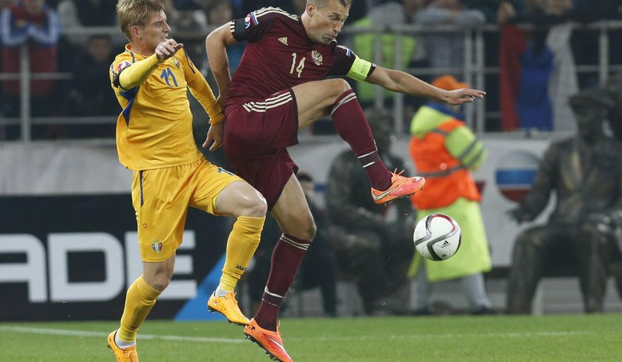 Moldova's Igor Picusceac, left, fights for a ball with Russia's Vasili Berezutski during an Euro 2016 Group G qualifying round soccer match between Russia and Moldova at the Otkrytie Arena of Spartak Moscow soccer club in Moscow, Russia, Sunday, Oct. 12, 2014. (AP Photo/Alexander Zemlianichenko)