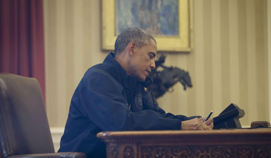 Seen through the window of his Oval Office, President Barack Obama talks with Health and Human Services Secretary Sylvia Burwell for an update on the new Ebola virus diagnosis in Dallas at the White House in Washington, Sunday, Oct. 12, 2014. (AP Photo/Pablo Martinez Monsivais)