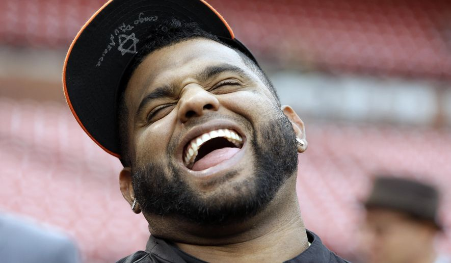 San Francisco Giants' Pablo Sandoval laughs during batting practice before Game 1 of the National League baseball championship series against the St. Louis Cardinals Saturday, Oct. 11, 2014, in St. Louis. (AP Photo/Jeff Roberson)
