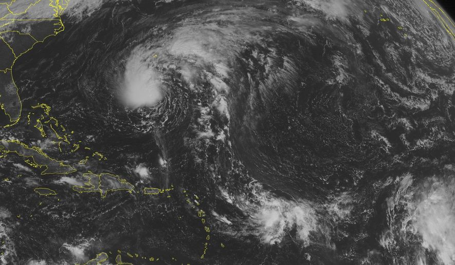 This NOAA satellite image taken Saturday, October 11, 2014 at 10:45 AM EDT shows Tropical Storm Fay in the southwestern Atlantic Basin. Fay is currently about 265 miles south of Bermuda moving northward with maximum winds of 70 miles per hour. Fay will pass just to the east of Bermuda as it is moves into the central Atlantic.(AP PHOTO/WEATHER UNDERGROUND)