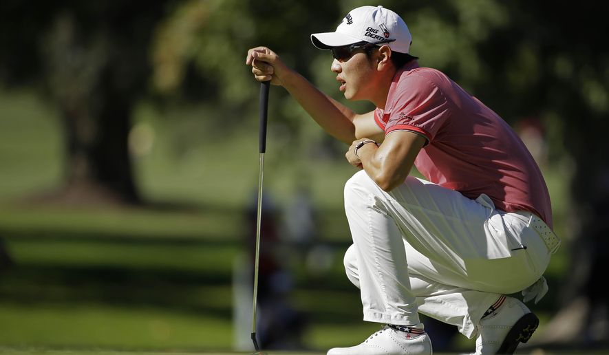 Bae Sang-Moon, of South Korea, lines up his putt on the sixth green of the Silverado Resort North Course during the final round of the Frys.com PGA Tour golf tournament Sunday, Oct. 12, 2014, in Napa, Calif. (AP Photo/Eric Risberg)