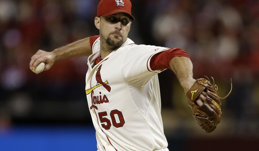 St. Louis Cardinals starting pitcher Adam Wainwright throws during the first Game 1 of the National League baseball championship series against the San Francisco Giants Saturday, Oct. 11, 2014, in St. Louis. (AP Photo/Jeff Roberson)