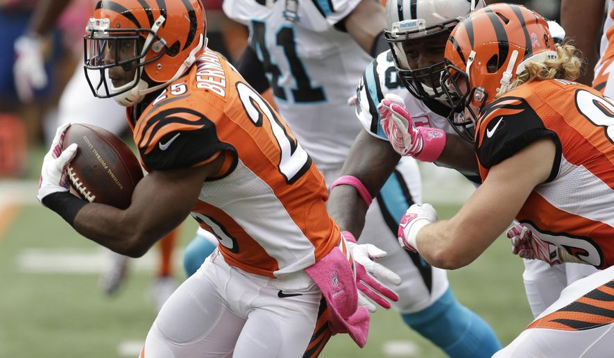 Cincinnati Bengals running back Giovani Bernard (25) breaks thru the line on his way to an 89-yard touchdown run against the Carolina Panthers in the first half of an NFL football game, Sunday, Oct. 12, 2014, in Cincinnati. (AP Photo/AJ Mast)