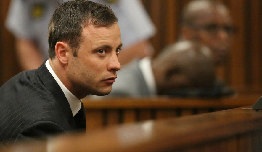FILE - In this Friday, Sept. 12, 2014 file photo Oscar Pistorius sits in the dock in court in Pretoria, South Africa, where Judge Thokozile Masipa found Pistorius guilty of culpable homicide for the shooting death of his girlfriend Reeva Steenkamp. Pistorius faces sentencing this week  (AP Photo/Siphiwe Sibeko, Pool, File)
