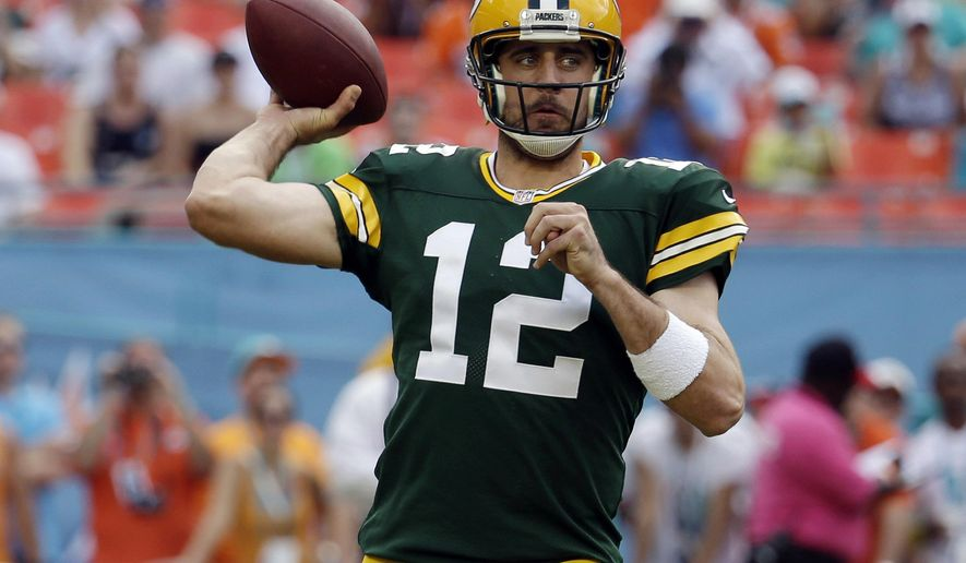 Green Bay Packers quarterback Aaron Rodgers (12) looks to pass during the first half of an NFL football game against the Miami Dolphins, Sunday, Oct. 12, 2014, in Miami Gardens, Fla. (AP Photo/Lynne Sladky)
