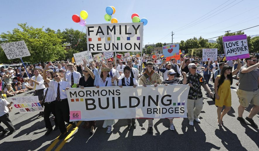 FILE - In this June 2, 2013, file photo, members of Mormons Building Bridges march during the Utah Gay Pride Parade, in Salt Lake City. Court decisions this week paving the way for same-sex marriage to become legal in dozens of states, including Mormon strongholds like Utah, Idaho and Nevada, have emboldened a growing group of Latter-day Saints who are pushing the conservative church to become more accepting of gay members. (AP Photo/Rick Bowmer, File)