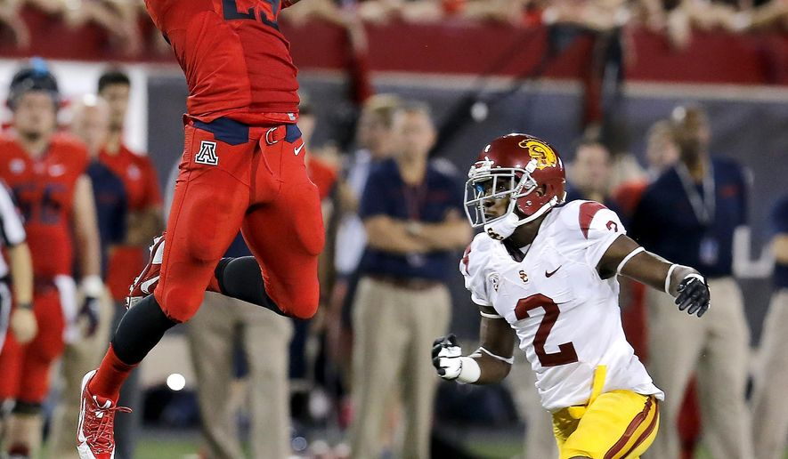 Arizona running back Austin Hill (29) makes the catch in front of Southern California cornerback Adoree' Jackson (2) during the first half of an NCAA college football game, Saturday, Oct. 11, 2014, in Tucson, Ariz. (AP Photo/Rick Scuteri)