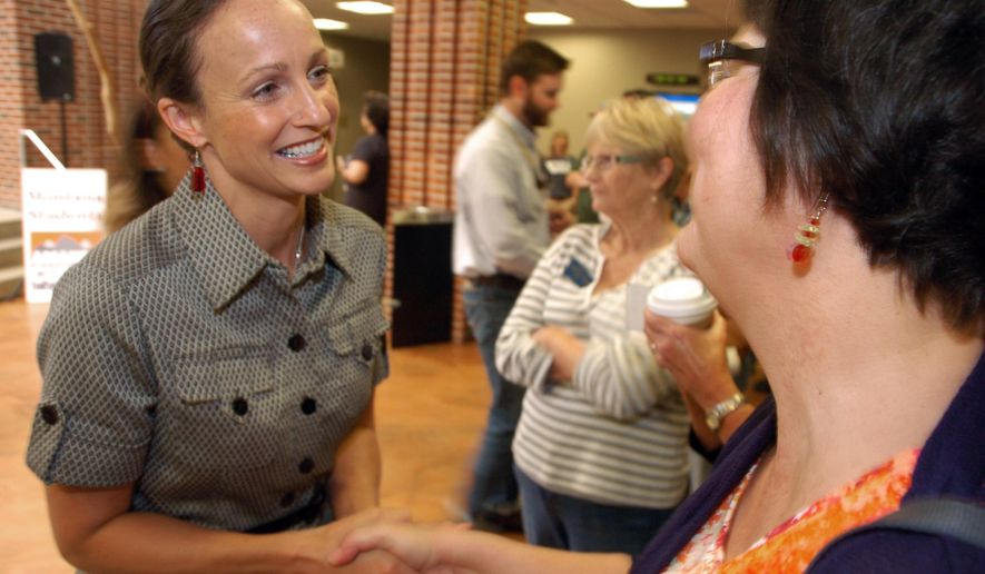 In this Sept. 3, 2014 photo, U.S. Senate candidate Amanda Curtis greets supporter Danell Jones during a campaign event in Billings, Mont. Curtis, a Democrat, faces Republican Rep. Steve Daines in the Nov. 4 election. (AP Photo/Matthew Brown)