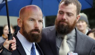 This Oct. 10, 2014, file photo shows Matthew Hamby, left, and Christopher Shelden speaking during a news conference following a hearing in federal court in Anchorage, Alaska. A federal judge has struck down Alaska's first-in-the-nation ban on gay marriages. U.S. District Judge Timothy Burgess on Sunday, Oct. 12, 2014, said the ban violates the U.S. constitutional guarantee of due process and equal protection. (AP Photo/Mark Thiessen) ** FILE **
