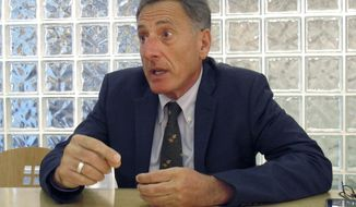 Democrat incumbent Vermont Gov. Peter Shumlin talks about his Republican opponent Scott Milne during an interview with The Associated Press, Monday Oct. 6, 2014 in Montpelier, Vt. Shumlin is seeking his third, two-year term and in the Nov. 4, 2014 election, where he will face Milne and Libertarian Dan Feliciano. (AP Photo/Wilson Ring)