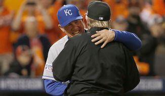 Kansas City Royals manager Ned Yost greets Baltimore Orioles manager Buck Showalter before the start of Game 1 of the American League baseball championship series Friday, Oct. 10, 2014, in Baltimore. (AP Photo/Alex Brandon)