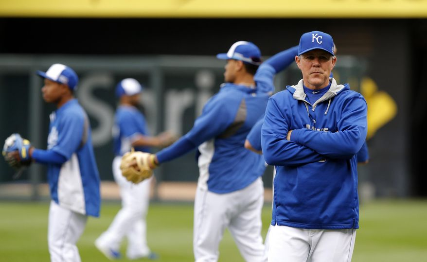 Kansas City Royals manager Ned Yost watches as his team works out on their off day during the ALCS baseball series Kansas City, Mo., Sunday, Oct. 12, 2014. The Royals are to face the Baltimore Orioles in Game 3 of the ALCS Monday. (AP Photo/Orlin Wagner)