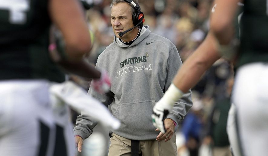 Michigan State head coach Mark Dantonio congratulates his team while playing Purdue during the first half of an NCAA college football game in West Lafayette, Ind., Saturday, Oct. 11, 2014. (AP Photo/AJ Mast)