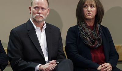 Michael Davis (left) and his wife Desiree lost their daughter Claire in a shooting at Arapahoe High School in Littleton, Colorado, last December. Arapahoe High School student Karl Pierson fatally shot Davis and then himself in the attack on Dec. 13, 2013. (AP Photo/David Zalubowski)
