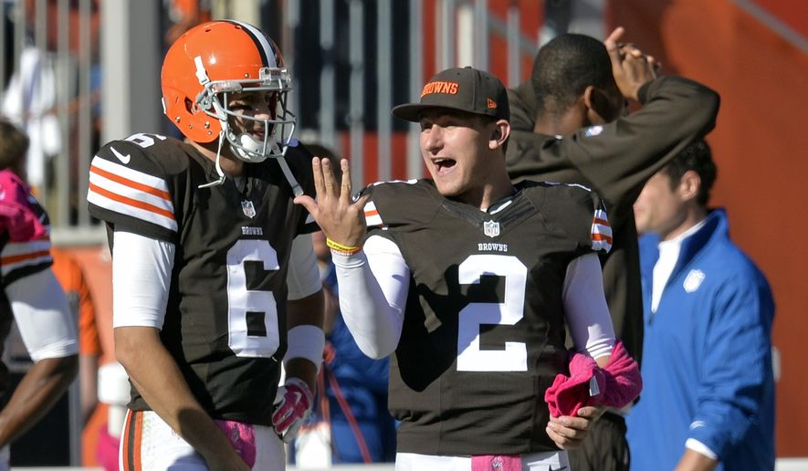 Cleveland Browns backup quarterback Johnny Manziel (2) talks with Brian Hoyer (6) on the sideline in the fourth quarter of an NFL football game against the Pittsburgh Steelers, Sunday, Oct. 12, 2014, in Cleveland. (AP Photo/David Richard)