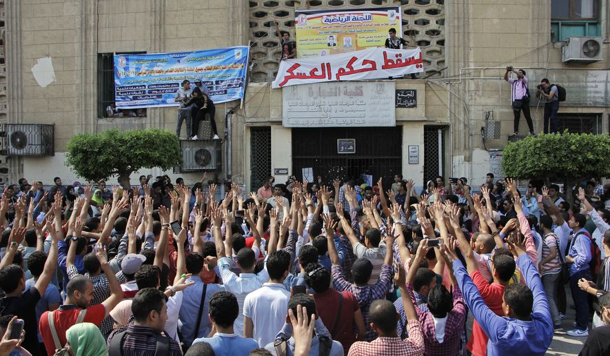 Student protesters hold a rally at Cairo University in Cairo, Egypt, Sunday, Oct. 12, 2014. Security officials said police backed by armored vehicles have stormed the campuses of at least two prominent Egyptian universities to quell anti-government protests by students. Sunday's largest rallies took place at Cairo and the Islamist al-Azhar universities. They were organized by supporters of ousted Islamist President Mohammed Morsi. (AP Photo/El Shorouk, Aly Hazzaa) EGYPT OUT