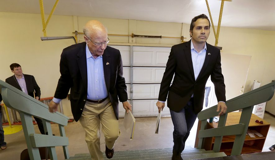 FILE - In this Sept. 6, 2014 file photo Republican Sen. Pat Roberts, left, and Greg Orman walk to the stage before a Senate debate in Hutchinson, Kan. Orman, an independent candidate challenging Roberts for the U.S. Senate in Kansas, has turned a longshot independent bid into a threat to the GOP veteran. Even if Roberts survives the challenge from independent Orman, Republicans also must lock down South Dakota, a once-unthinkable concern. (AP Photo/Charlie Riedel, File)
