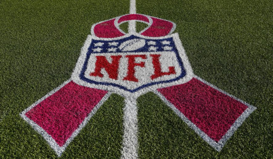 A pink ribbon has become the universal logo for Breast Cancer Awareness Month, as seen on this NFL field. (AP Photo/Mike Groll)